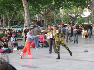 Dancers in a park in Hangzhou. You haven't seen it all until you've seen a ballet-dancing soldier.