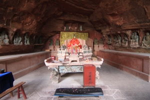 Altar with statues in a cave recess