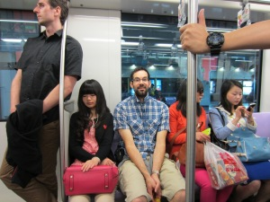 Frank and Chris on the Shanghai subway and ladies with cool purses and sunglasses
