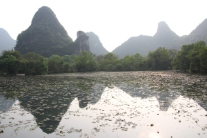 Mountains reflected in a lily pond in Yangshuo